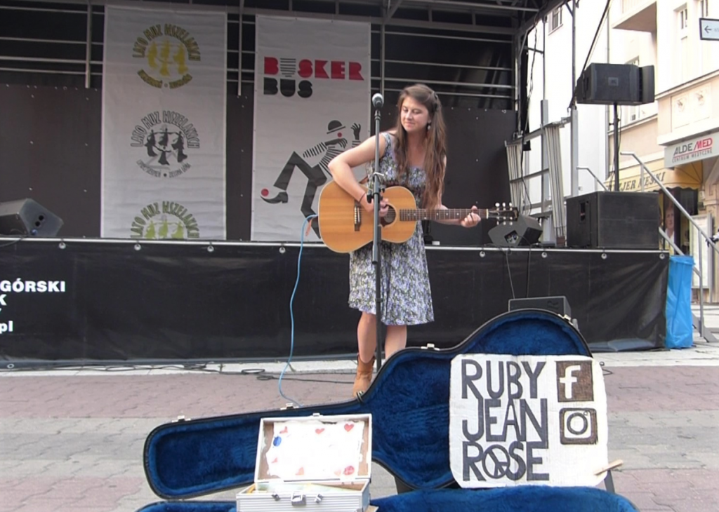 Street musician Ruby Jean Rose performing in Zielona Góra