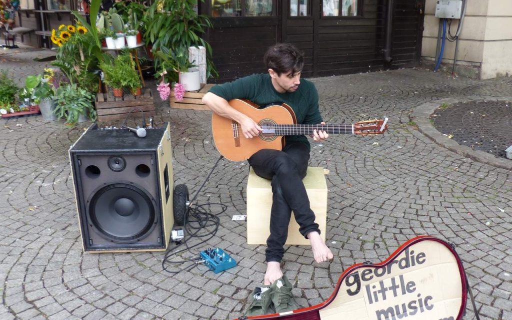 Guitarist Geordie Little performing at BuskerBus